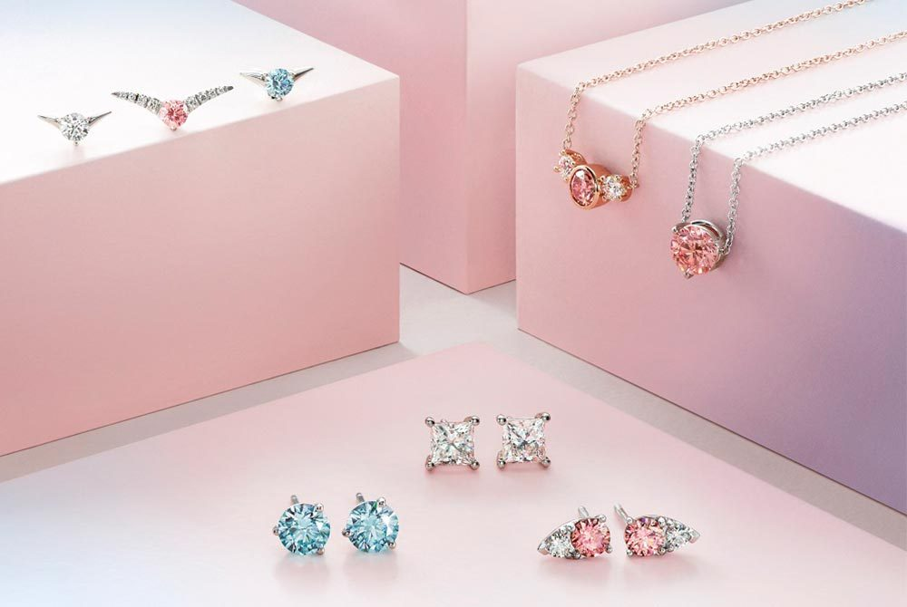 White, blue and pink lab grown diamond jewellery pieces by Lightbox Jewelry. Photo: De Beers